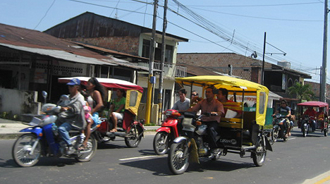 Moto-cars and motorbikes are the main form of travel on the streets of Iquitos.