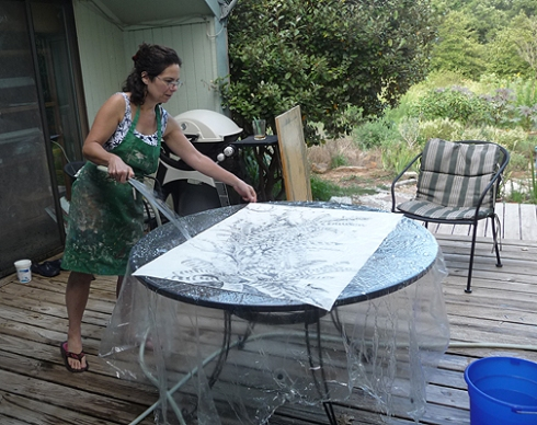 The water cure. There's a shower curtain over the patio table to puddle water on. The idea is to wash off the loose graphite and get the paper REALLY well soaked.