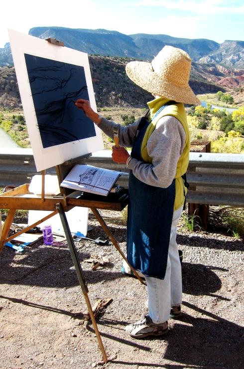 Janet Palin, working her magic. Chama River overlook, Abiquiu, NM.