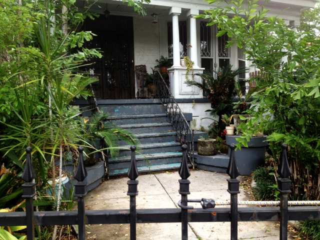 A fine and private place; the little courtyard gardens of New Orleans entice discreetly from behind iron spikes.