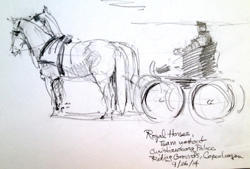A team of two white horses draws the little rig and driver. I don't know what the official name for the vehicle is. A buggy? A mini-coach? cabriolet? sulky? practice- phaeton?