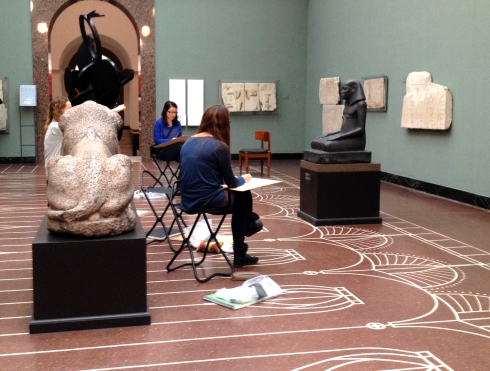 Sketchers draw in the Egyptian Room at Copenhagen's Ny Carlsberg Glyptotek.