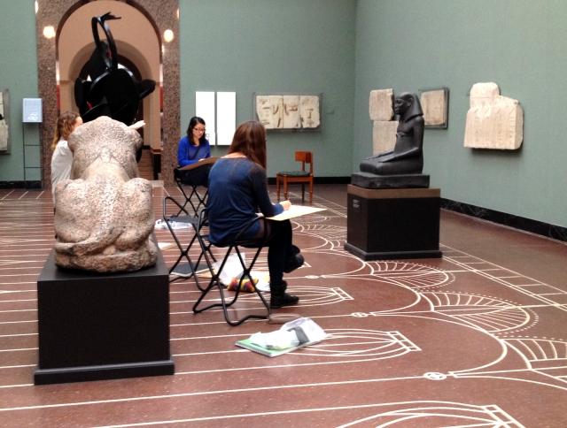 Sketchers draw in the Egyptian Room at Copenhagen's Ny Carlsberg Glyptotek.